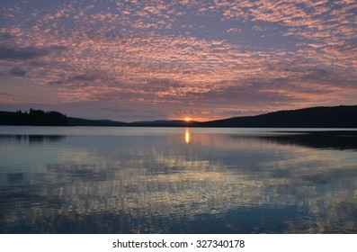 Sun rising over Lake of Two Rivers  in Algonquin Park, Canada.