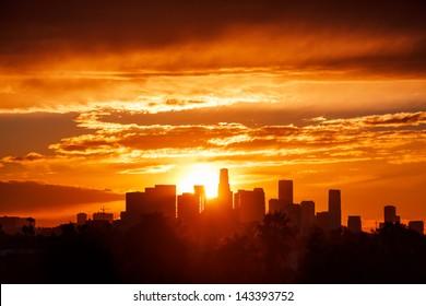 Sun rising over Los Angeles city skyline