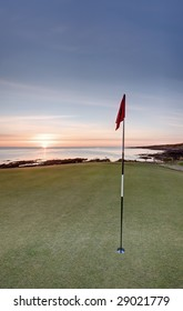 The sun rising over the sea from the new Castle Course in St Andrews.