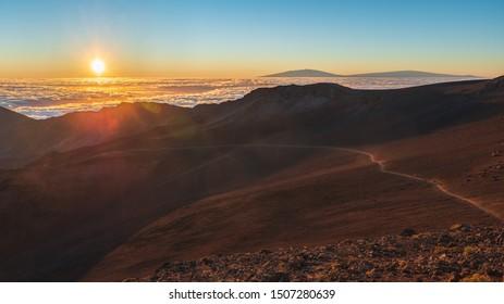 Sun rising over the sliding sands trail in Haleakala National Park, Maui.