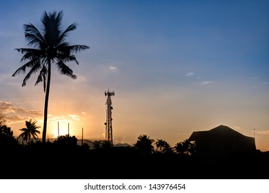 The sun rising over a small village in the Philippines