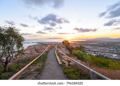 Sun rising over Townsville, Queensland from Castle Rock
