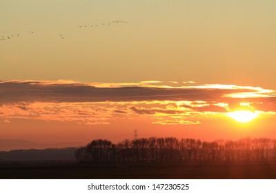 sun rising in the Po Valley