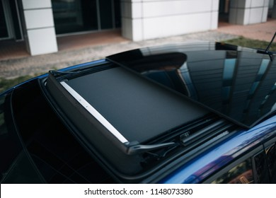 Sun roof with sunshade. Panoramic hatchback car roof is open