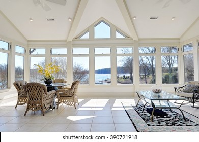 Sun Room with Large Windows Overlooking Lake