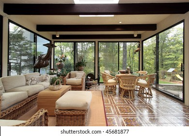 Sun room in luxury home with patterned tile