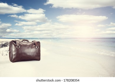 sun and sand with suitcase