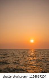 sun and sea evening sky