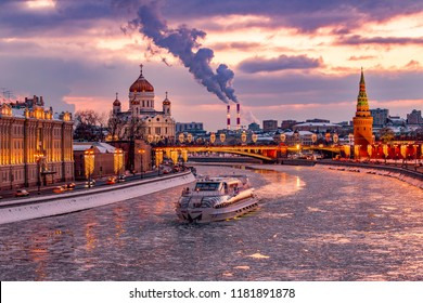 Sun set in moscow in winter. Kremlin - moscow river and Cathedral Christ the survivor in the frame