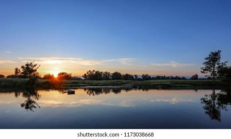 Sun Set Over The Meadows