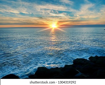 Sun set over Pacific ocean at Depoe Bay, Oregon