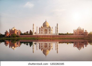 Sun set at Taj Mahal seen from Mehtab Bagh reflect on Yamuna river, an ivory-white marble mausoleum on the south bank of the Yamuna river in Agra, Uttar Pradesh, India.