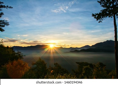 Sun set view over mountains with fog on floor ground in the morning. Alishan National Forest Recreation Area in Chiayi County, Alishan Township, Taiwan
