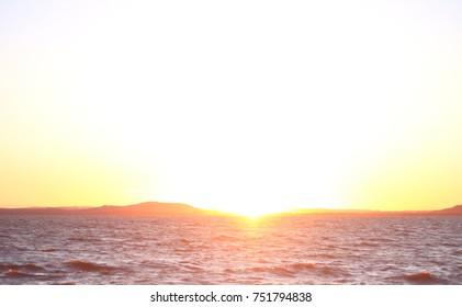 Sun seting over Guaiba Estuary. View from Ipanema Beach, Porto Alegre's South Zone