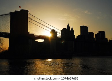 The Sun Sets Behind the Brooklyn Bridge and Lower Manhattan