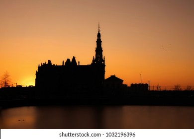The sun sets behind a building in Antwerp. Leaving a beautiful silhouette behind.