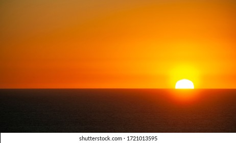 Sun sets behind the horizon in Portugal