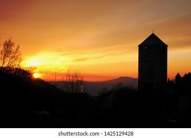 The sun sets behind the Lichtenberg castle in Germany. Burg Lichtenberg is located near Thallichtenberg in the district of Kusel in Rhineland-Palatinate Deutschland.