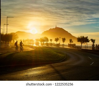 The sun sets behind the Monte Urgull of San Sebastian, Basque Country, Guipuzcoa. Spain. View from Zurriola Avenue.