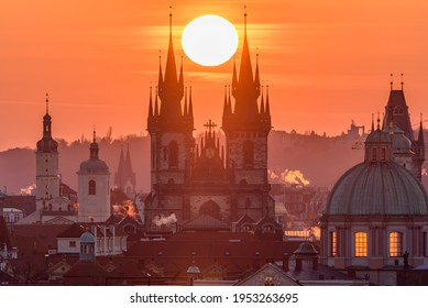 The sun sets up in between towers of the Church of Our Lady before Týn in Prague. - Shutterstock ID 1953263695