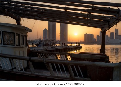 The sun sets as fishermen cast off of a pier in Bahrain. Manama, Bahrain October 1, 2017.