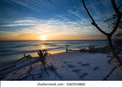 Sun sets into the Gulf of Mexico on Longboat key beach