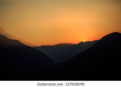 Sun Sets In Mt. Rainier National Park In Washington State