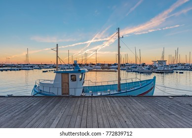 The sun sets at the norra hamnen Marina at Helsingborg in Sweden.