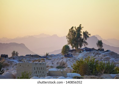 The sun sets on an Afghan National Police Outpost nestled among the craggy peaks of Kandahar Province, Afghanistan