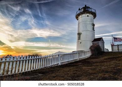 Sun Sets On Nobska Light Setting sun lights up the sky above Nobska Light in Woods Hole, Massachusetts.