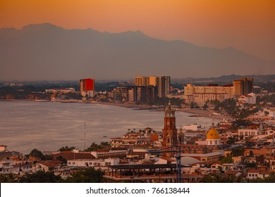 The sun sets on Puerto Vallarta, Jalisco, Mexico and Parish of Our Lady of Guadalupe church along the Pacific Ocean November, 13, 2017.