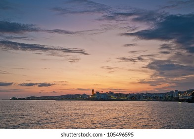 Sun sets on Sitges village on southern Barcelona in Catalonia Province, Spain