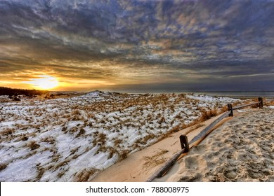 The sun sets on a snow covered Crosby Landing Beach in Brewester Massachusetts January 11, 2011.