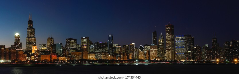The sun sets over the Chicago skyline