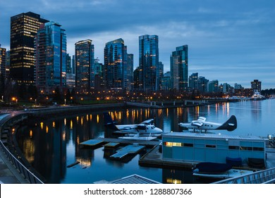 The sun sets over Coal Harbour in Vancouver, Canada.