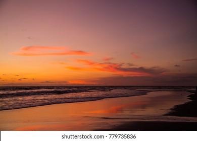 The sun sets over Echo Beach in Bali