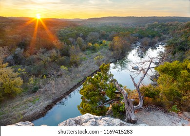 The sun sets over the Greenbelt in Austin, Texas