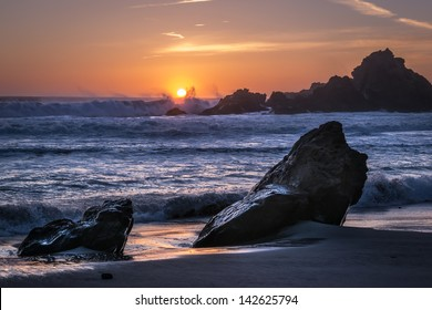 The sun sets over Pfeiffer Beach in Big Sur, California.