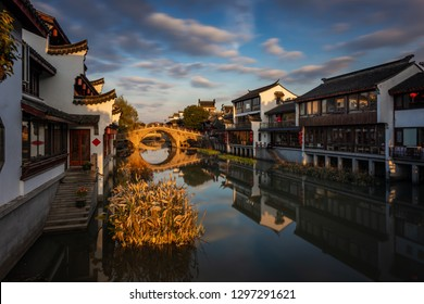 The sun sets over Qibao Ancient Town, a historical water village on the outskirts of Shanghai, China.