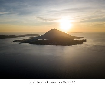 The sun sets over the remote islands of Banda Neira in Indonesia. This tropical island group and region is known for its extraordinary marine biodiversity.