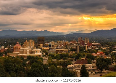 The sun sets over the town of Asheville, North Carolina