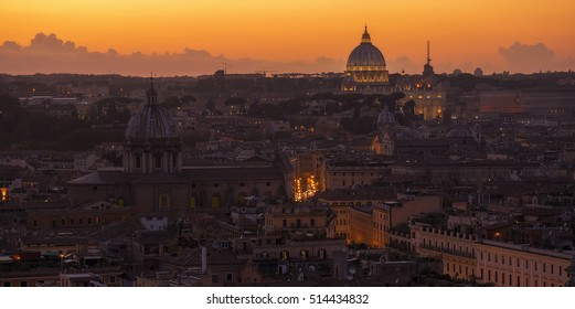 The sun sets over the Vatican and the rest of Rome, Italy.