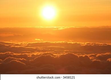 Sun setting above the clouds at 14,000 feet on Mauna Kea,  Hawaii