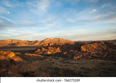 The sun setting across the mountains at Hueco Tanks in El Paso, Texas.