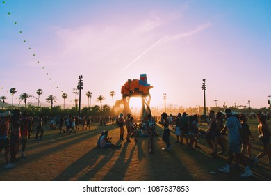 sun setting behind art installation at coachella, california, 2018
