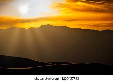 The sun setting behind the mountains near Alamogordo, New Mexico.