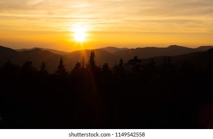 The sun setting behind mountains in Pemigewasset Overlook, New Hampshire.