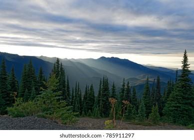 Sun setting behind the Olympic Mountains on Olympic National Park, Washington