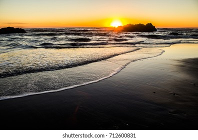 Sun Setting Behind a Sea Stack in Lincoln City on the Oregon Coast