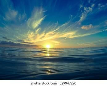 Sun setting in the blue caribbean sea